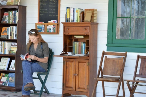 Porch Library 2014: Casey Cruikshank consults Kaufman's Field Guide to Birds of North America. By the end of the day, Casey added a half dozen new birds to the Buffalo Peaks Ranch Bird List (the handy chalkboard posted on the main house's front wall).  photo by Kalen Landow