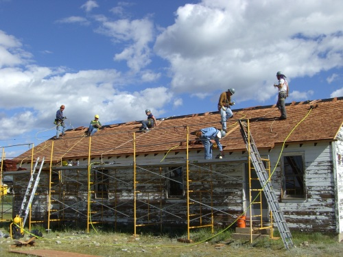 Such a great team! the last row of the Cook House's cedar shingles fall into place