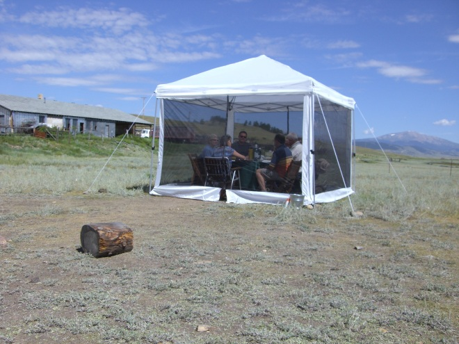A tent full of poets, with Mount Silverheels up valley.