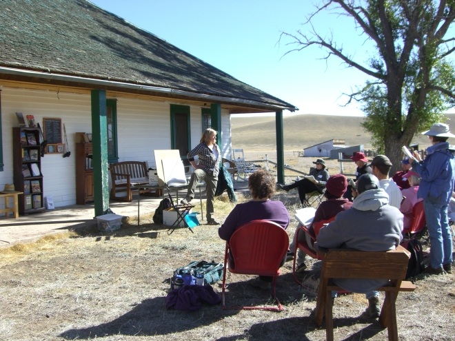 Sherrie York leading the class in a gesture drawing exercise, with Reinecker Ridge in the distance.